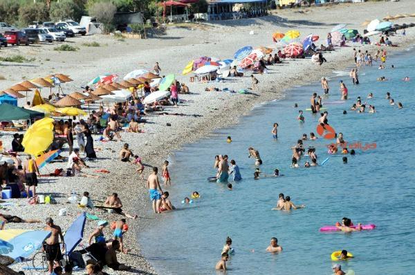 2019/08/demre-sahilleri-tatilcilerle-doldu-22071b171bdc-1.jpg