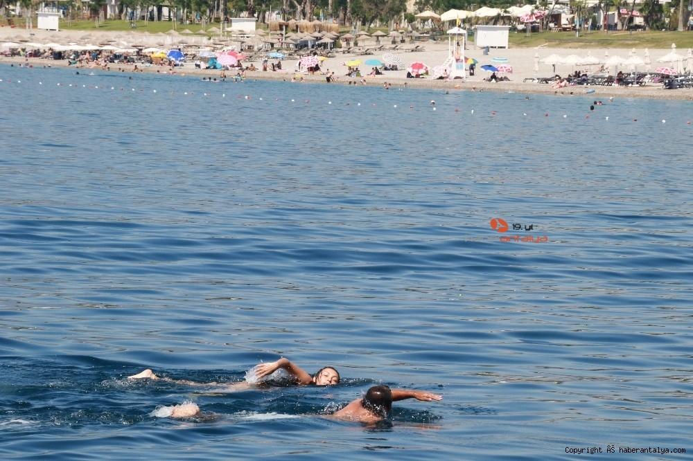 2020/07/deniz-polisi-dunyaca-unlu-sahil-ve-koylari-tek-dolasip-maske-ve-sosyal-mesafeyi-denetledi-20200703AW05-14.jpg