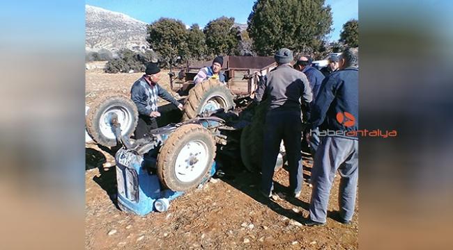 Devrilen traktörün altından kurtarıldı