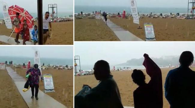 Şiddetli yağmura plajda yakalandılar !
