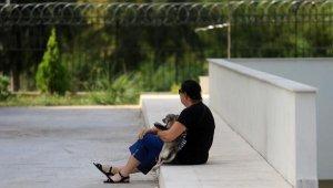 Milli antrenörün cenazesini köpeği 'Kropi' ile bekledi