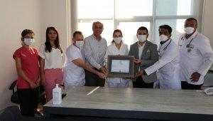 Belediye Tıp Merkezi'nin ruhsatı hekimlere teslim edildi