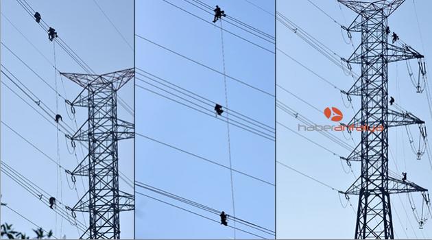 80 metrelik yüksek gerilim hattında cambaz gibi çalışıyorlar