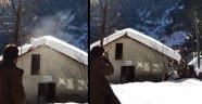 Çatıdaki kar kütlesini, ateş ederek temizledi