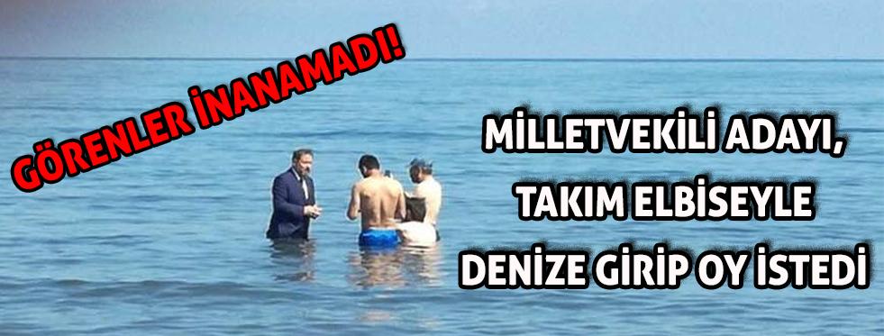 Milletvekili adayı takım elbise ile denize girip, yüzenlerden oy istedi